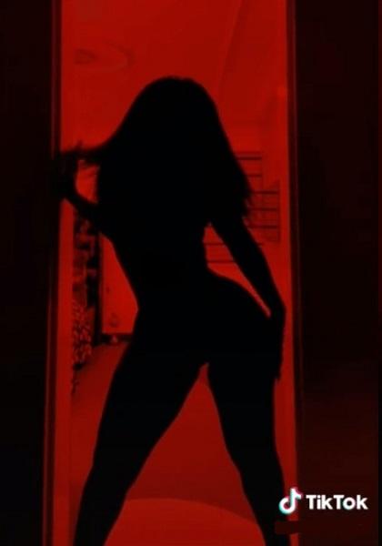 Women doing silhouette TikTok warned about hackers
